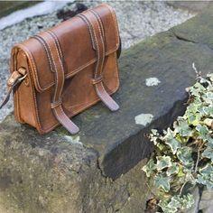 Leather messenger bag by avis