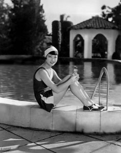 Silent and sound movie star, Anna May Wong, sitting poolside.