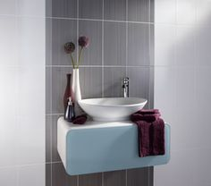 The Brighton collection is made up of contemporary ceramic wall tiles with a gloss finish and linear design with coordinating floor tiles and borders. This grey tile works perfectly with the brighter colours in the range. Fun Bathroom Decor, Gray And White Bathroom, Grey Bathroom Tiles, Grey Bathroom Wall Tiles, Bathroom Wall Coverings, Gray Bathroom Walls, Bathroom Wall, White Wall Tiles, Bathroom Wall Tile