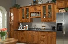 Image result for grey counter with medium.stained cabinets