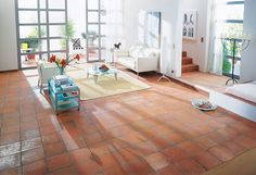 Priced at only 39p per tile, this traditional red quarry design from Walls & Floors is a practical, low-cost option