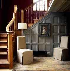 Create a sitting area in the space under the staircase. Love the paneled walls! ~ The Sixth Duke: