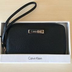 New Listing Calvin Klein Wristlet NWT - Don't just hold your phone, keep it protected.   This wristlet doubles as a wallet and phone carrier.   There is a slot for ID, credit cards, bills and phone. Calvin Klein Bags Clutches & Wristlets