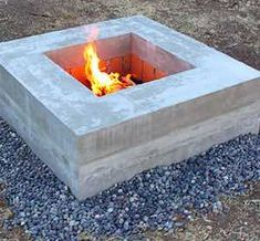 Give your backyard a makeover with one of these warm and cozy DIY fire pits. From cheap and easy portable fire pits to in ground fire pits for large areas, there are plenty of outdoor ideas for every size, style and budget. Fire Pit Gravel, Garden Fire Pit, Concrete Fire Pits, Fire Pit Backyard, Fire Pit Uses, Fire Pit With Rocks, Diy Fire Pit, Outside Fire Pits, Cool Fire Pits