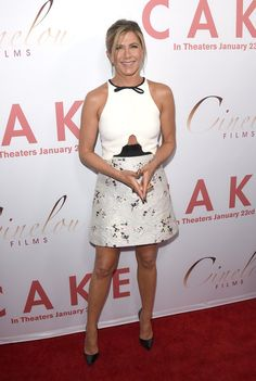 Pin for Later: 28 Style Lessons You'll Thank Jennifer Aniston For A little skin gives a girlie dress some edge.