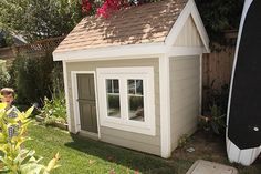 Beautiful kids playhouse with dutch door and vegetable garden off the side.