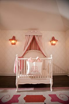Lovely little nursery. Sconces provide a soft glow and task lighting when needed.