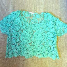 Mint green knit top Mint green knit top, size is large but fits more like a medium Delia's Tops