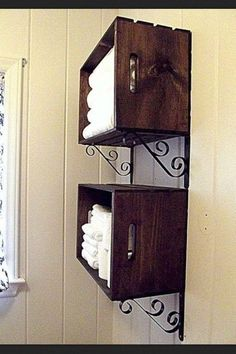 Wood crates stained with plant hangers underneath to make towel shelves