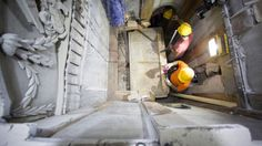 This Wednesday Oct. 26, 2016 shows the moment workers remove the top marble layer of the tomb in Jerusalem's Church of Holy Sepulchre. (Dusan Vranic/National Geographic via AP)