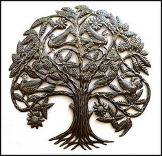 We want to do a Tree of Life motif in the living room. These metal wall sculptures made in Haiti would be gorgeous. Birds in Tree Metal Wall Hanging  Haitian by HaitianMetal on Etsy, $139.95
