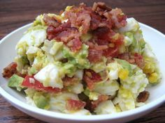 Super simple BLT/Egg salad: 1 ripe avocado, chopped into chunks; 2 boiled eggs, chopped into chunks; 1 medium-sized tomato, chopped into chunks; Juice from one lemon wedge; 2-4 cooked pieces of bacon, crumbled; sea salt and freshly ground pepper to taste... Mmmm Bacon