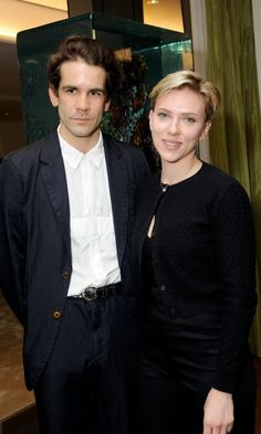 Scarlett Johansson posed with her ex Romain Dauriac at the Singular Object Art Opening Cocktail Reception at 53W53 Gallery in New York City. The friendly exchange comes merely a month after Scarlett filed for divorce.