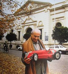 What a lovely photo of Manuel Fangio with a scale model of his Mercedes. Maserati, Ferrari, Grand Prix, Aston Martin, Classic Race Cars, Porsche, Formula 1 Car, Vintage Racing, Vintage Auto