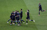 England players surround teammate Theo Walcott, hidden, as they celebrate his scoring their second goal during the Euro 2012 soccer championship Group D match between Sweden and England in Kiev, Ukraine, Friday, June 15, 2012. (AP Photo/Darko Vojinovic)