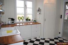 Scandinavian kitchen - new sink counter-tops and linoleum floors