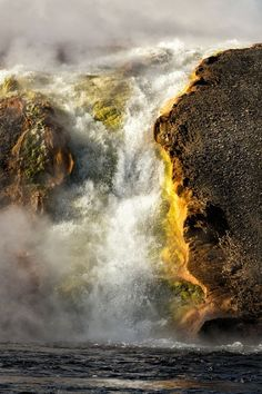 """Prismatic Springs in October Photo by donna fullerton — National Geographic Your Shot """"We followed the boardwalk around the springs in Yellowstone early one October morning. I loved it but my favorite area was down by the river. I sat there in the cold for a while enjoying the sights and sounds."""" Yellowstone NP"""