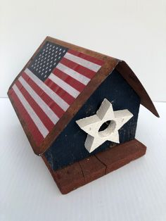 Excited to share this item from my #etsy shop: Vintage, Handmade Birdhouse, Patriotic, Wooden, Birdhouse with American  Flags Attached to Tin Roof and White Star Opening for Birds #blue #independenceday #red #vintagebirdhouse #handmadebirdhouse #americanbirdhouse #patrioticbirdhouse #usabirdhouse #fourthofjuly