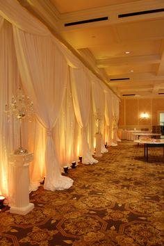 White Backdrop with Amber LED up lighting
