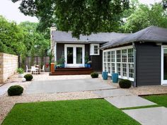 The backyard of this 1930s Austin, Texas, cottage doubles as a parking area and a party space.