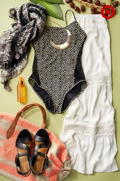 Finding the perfect one-piece is just as easy as finding the perfect bikini. Pair it with a boho-cool white maxi skirt for a beach-to-street look you can wear all day. Don't forget to toss some sea salt spray for beachy hair, a pair of sandals, and a scarf as a coverup into an embroidered beach bag—you're set.