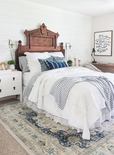 How I refreshed my bedroom for spring using a blue and white color pallet with natural wood accents. Mixing new and vintage items to create a timeless look.