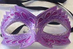 This new venetian style masquerade mask is a classic purple and silver with ridged design. This mask is paper mache with ribbon tie concept to create a comfortable fit and great to reuse if needed.  This mask is 10 inches across and 3 inches high Masquerade Masks #reflections_vintage_toronto #masks #masquerade #masqueradeball