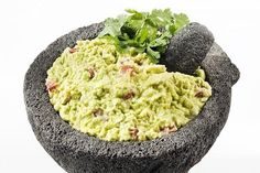 """Greek Guacamole  Puree an avocado, add chopped olives and tomatoes, sprinkle with feta cheese and you have a healthy guacamole that you can serve on whole-wheat pita slices. Avocados are one of the few fruits that provide """"good"""" fats, with 3 grams of monounsaturated fat and 0.5 grams of polyunsaturated fat per ounce."""