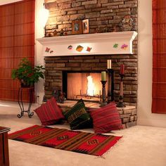 Pillows Plant Candles Rug In Front Of Fireplace Living Room With