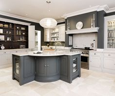 This sleek painted kitchen is a contemporary twist on a traditional shaker style featuring bespoke cabinetry and dark oak kitchen dresser. Kitchen Larder, Kitchen Dresser, Shaker Kitchen, Larder Cupboard, Kitchen Cabinets, Kitchen Interior, Kitchen Design, Kitchen Decor, Room Interior