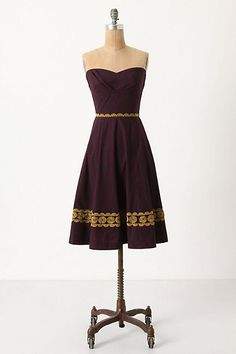 anthropologie aubergine sky dress with a big deep burgandy rose in the tied to the side hair.