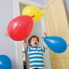 Surprise Balloon Swarm.  Blow up 3 balloons, wind their tails together (don't knot them). Stick the twisted tails between the door and door frame, close the door to hold them in place. When someone walks through the door, the balloons will fly.
