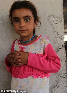 An Iraqi Yazidi girl, who fled her home when Islamic State (IS) militants attacked the tow...