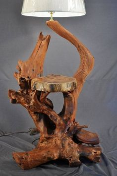 We have upcycled many useless materials into lamps earlier in our website. But driftwood lamp among all other crafts is probably the most astonishing and great idea. We have employed driftwood in so many ideas that I strongly believe that whenever yo Driftwood Flooring, Driftwood Furniture, Driftwood Lamp, Driftwood Projects, Driftwood Sculpture, Rustic Furniture, Driftwood Ideas, Diy Projects, Rustic Lamps