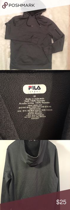 FILA Sport Men's Pullover Hoodie This FILA Sport Pullover is in excellent condition and great for the upcoming fall weather. It even has an external zip pocket on the upper arm (and a hole for earbud connectivity) for your phone/small electronic device. Fila Jackets & Coats
