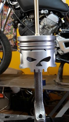 Lamp made from real mechanical parts.  Pistons and connecting rods in large diameter, total height (without Lampshade) 42cm, Worked way Skull Black base, solid oak Turned custom bronze parts. All defatted, sanded, polished and painted by hand.  Unique and numbered object.  Sold without shade.  Decoration loft, biker, biker, racing driver, mechanical art, factory, industrial deco vintage design, jieldé, JLD, metal, Harley Davidson