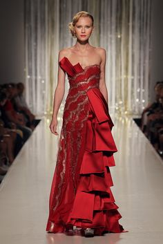 TONY WARD - Red asymmetric lace evening dress with cascades of Duchess satin pleats.