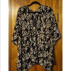 Kimono Geometric Print Never worn. Size XL fits more like an L. I did take the tags off of it. Lands about where a mini skirt would. Fabric is a soft and smooth rayon poly blend. Washable. Ashley Blue Tops Blouses