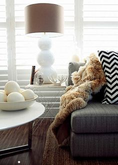 lamp, fur, chevron, natural light, charcoal gray - so much to like in this room