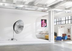 wow. check the seamless cove built into the wall. AMAZING! -- this would be the photo half of my studio.
