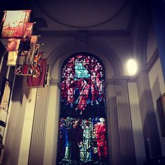 The interior of the Birmingham Cathedral. If we look closely we see modern construction methods. Note the patriotic flags. Yes!