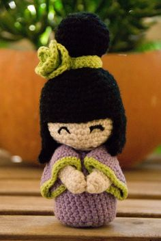 This ready to ship cute kokeshi doll is handmade using organic cotton yarn and wool yarn for the hair only. It wears a kimono in purple and green and even