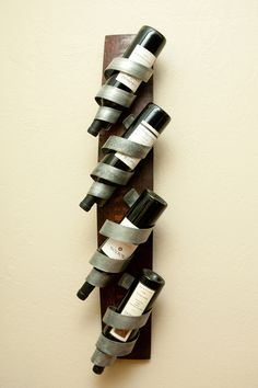 Cool wall-mounted wine rack. Makes me think of something Wine Country Craftsman would make! http://www.custommade.com/by/winecountrycraftsman/
