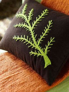 Sew Chic -- Sew Chic  Natural touches, like this handmade pillow, add warmth and personality to the room.