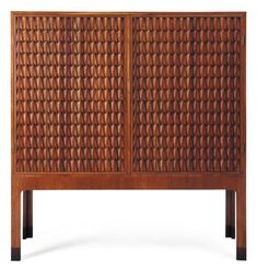 "Hans J. Wegner, ""Crocodile"" Carved Oak Cabinet, c1950."