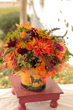 Bright autumn flowers -- this would be the size of a large centerpiece