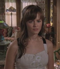 Gilmore Girls Season 7 - really like the shape of this dress with the flare skirt, the square neck and the cross back but not sure how I feel about the extremely stiff fabric (also don't like the washed out colors or the strange round flowers on the front)