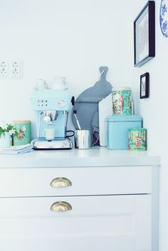 Maybe tins covered in fabric (modgepodge) might work for kitchen storage. Container store has tins.