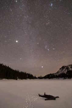Laying in the snow to look at the Stars in the winter night sky. Peaceful