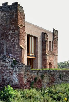 A contemporary house inserted into the twelfth-century ruins of Astley Castle in Warwickshire by Witherford Watson Mann